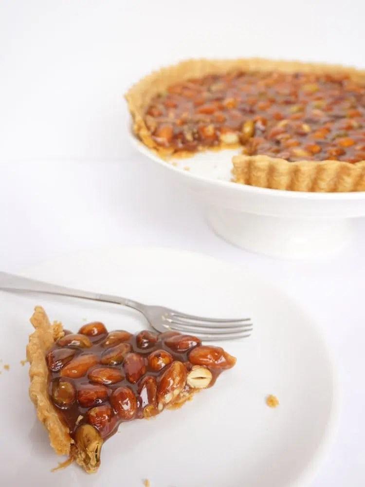 slice of nut caramel tart