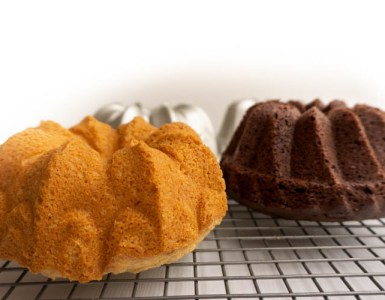 close up side view of two small bundt cakes