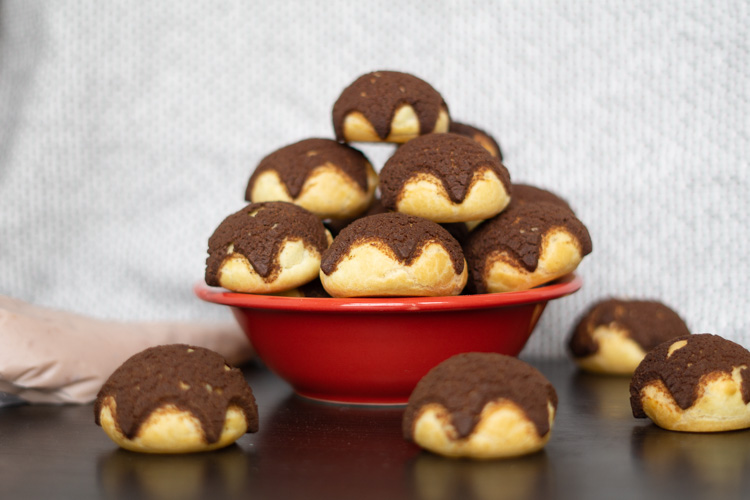 bowl of choux pastry puffs with craquelin chocolate