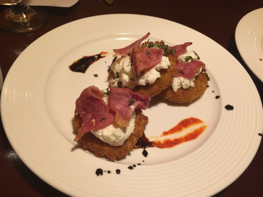 Fried Green Tomato Napoleon layered with Wayco County Ham and honey whipped Holly Grove Goat Cheese