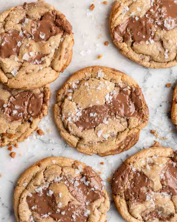 Chewy golden Toffee Milk Chocolate Chip Cookies on marble counter