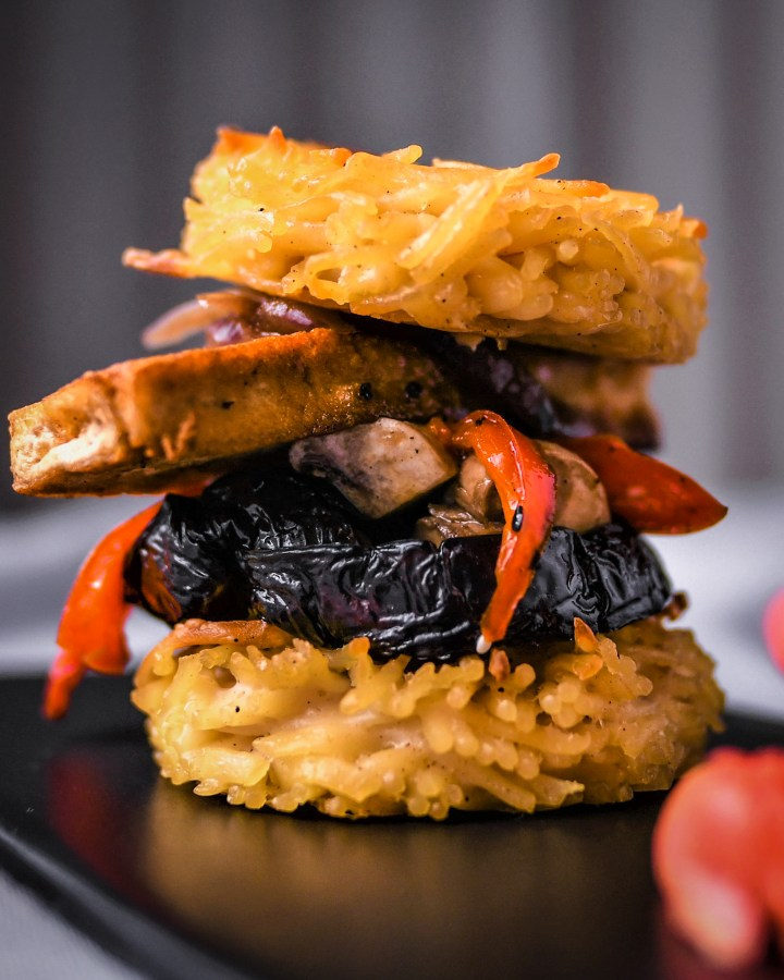 spaghetti sandwich filled with fried tofu fillets, mushrooms, peppers and aubergine