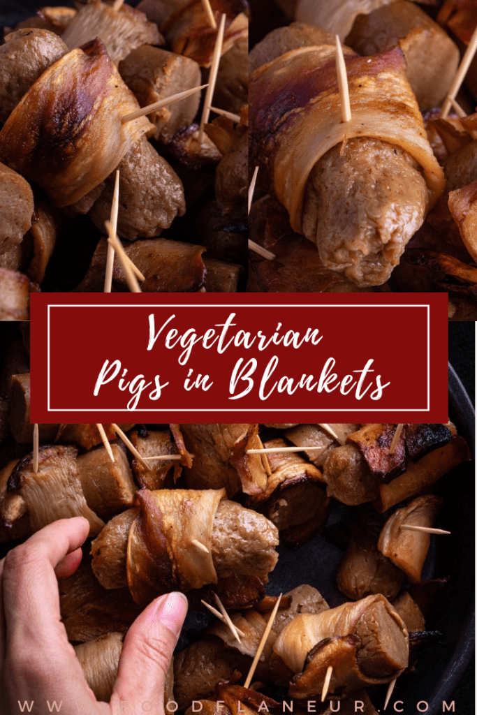 hand holding vegan pigs in blankets held above tray filled with several mini pigs in blankets