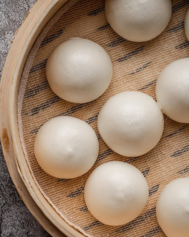 steamed fluffy soft chinese custard buns in bamboo steamer
