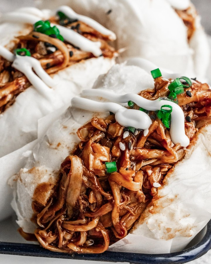 chinese baozi filled with vegan pulled pork and chives