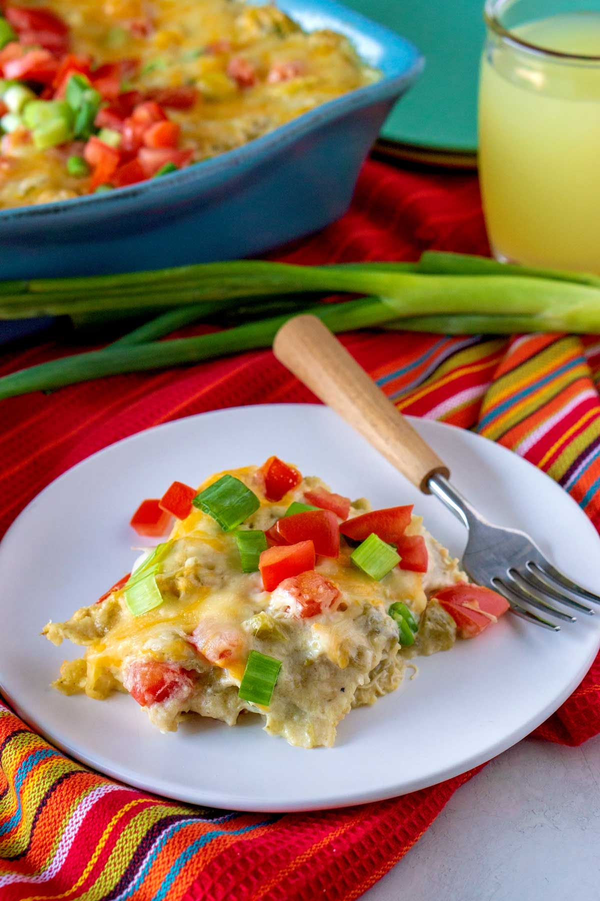 Stacked Chicken Enchiladas on a white plate.