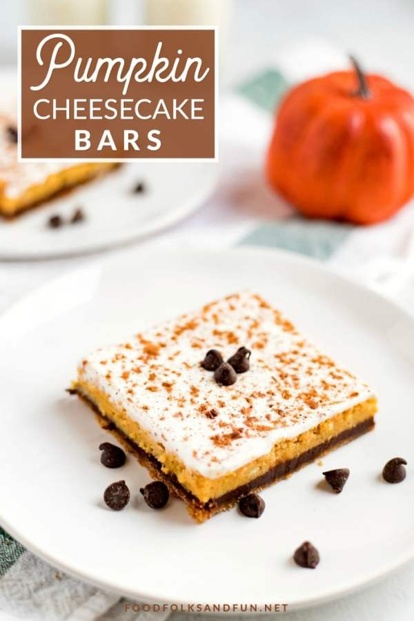 The finished pumpkin cheesecake bar on a white plate with text overlay on the picture for Pinterest.