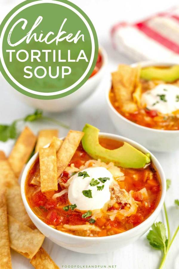 Tortilla soup ladled into bowls.