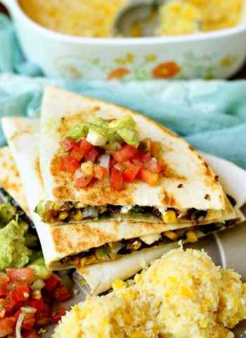 Mexican Sweet Corn on a plate next to Veggie Quesadillas