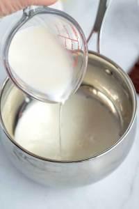 Heat the cream until simmering.