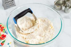 Use a pastry cutter to cut in the butter into the flour mixture.