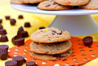 Loaded Peanut Butter Cookies - they're big, chewy, and full of peanut butter goodness. They're loaded with Reese's Pieces and Reese's Mini Peanut Butter Cups.