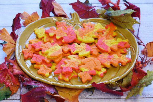 Fall leaf cookies on a pumpkin plate.