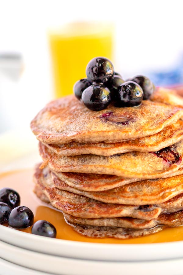 A closeup picture of a stack of buckwheat pancakes.