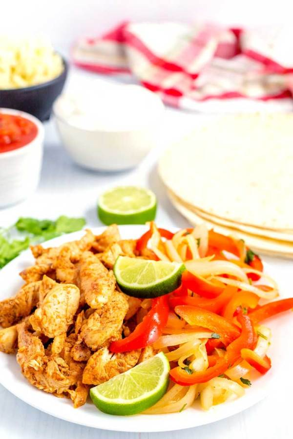 Chicken fajitas on a serving platter ready to be served.