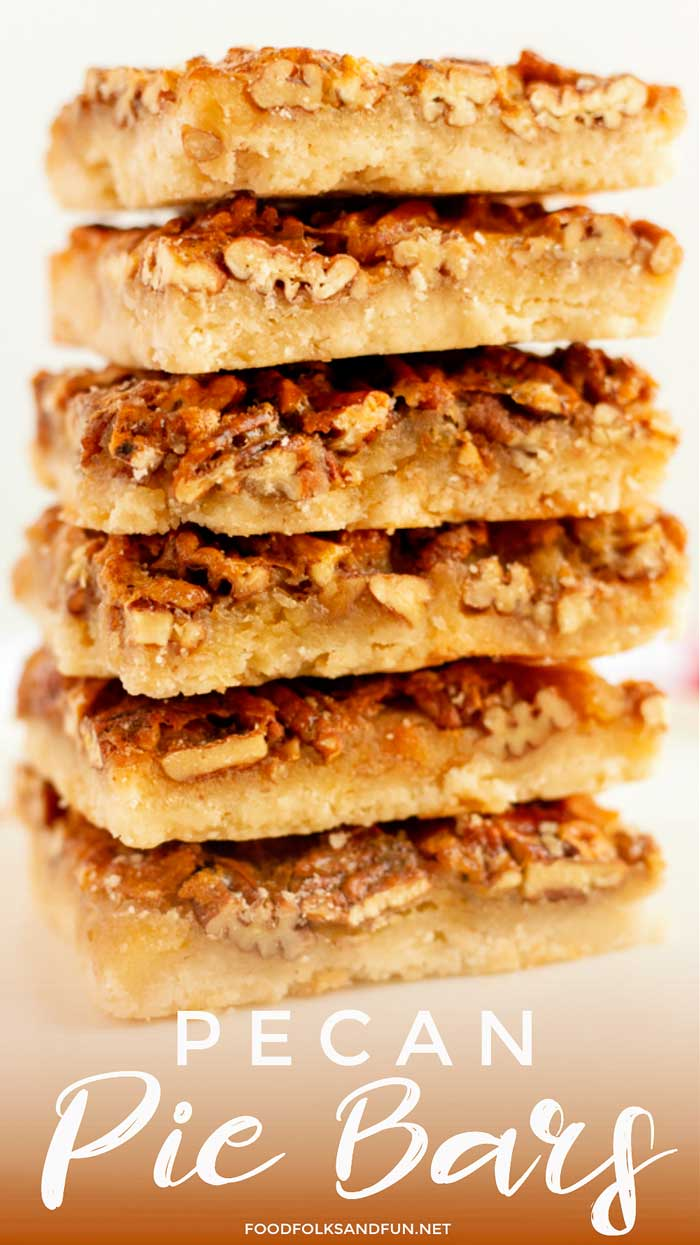 Pecan Pie Squares stacked on top of each other.