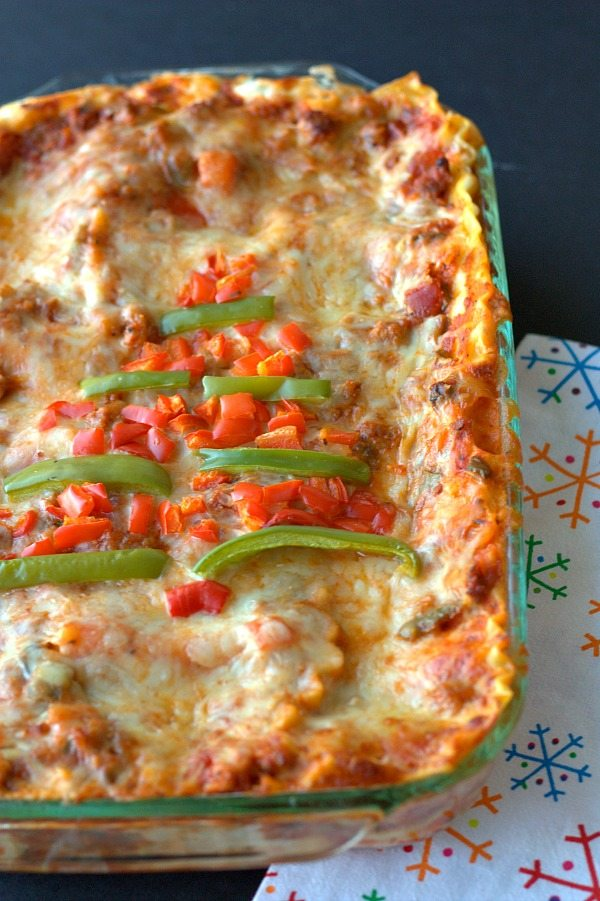 Full lasagna with a bell pepper Christmas tree on it.