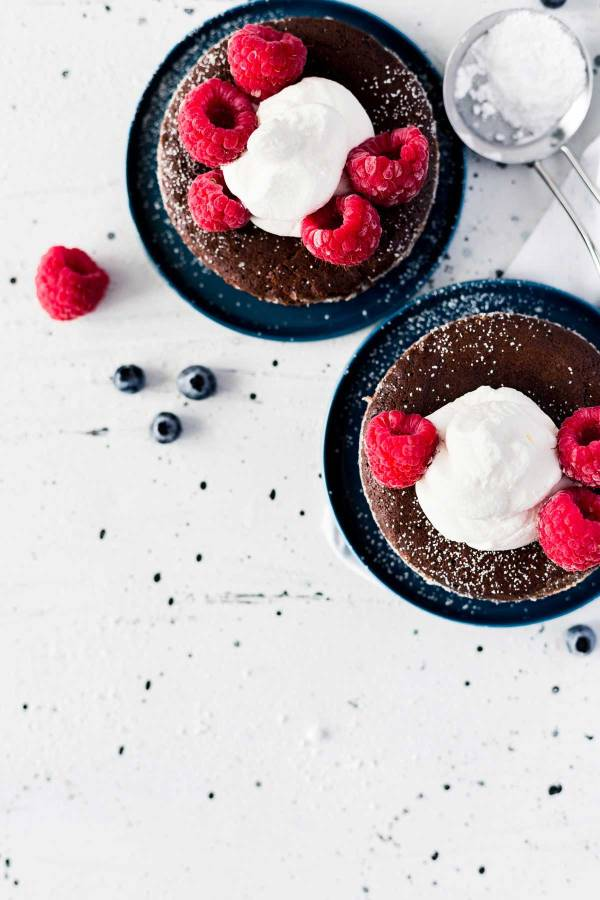 Delicious Soft Centered Fudge Cake with berries.