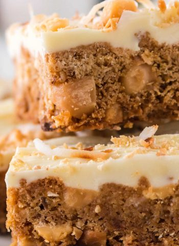A close up picture of White Chocolate Blondies stacked on top of each other.