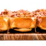 A closeup picture of the finished sticky buns on a wooden board.