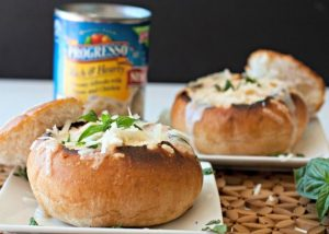 Parmesan Bread Bowls on a plate with a can of soup in the background