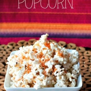 Spiced Parmesan Popcorn in a bowl with text overlay for Pinterest