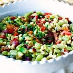 Succotash with bacon and scallions in a serving bowl