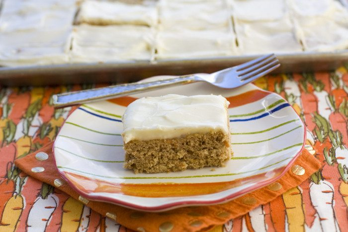 A carrot cake cookie bar on a striped plate.