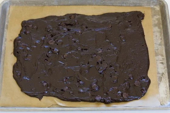 Use an off set spatula to spread the brownie batter.