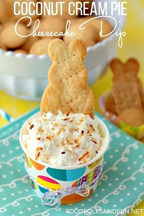 A cup full of coconut cream pie cheesecake dip.