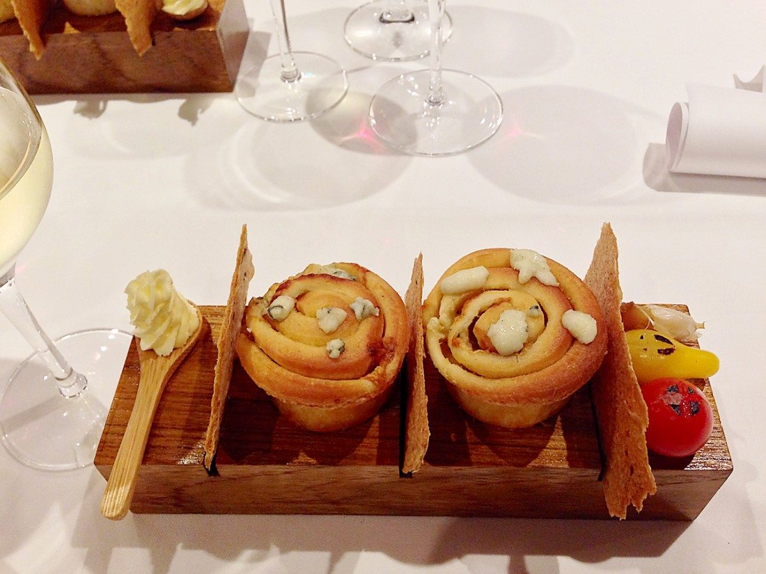Bread with butter on a wooden serving tray
