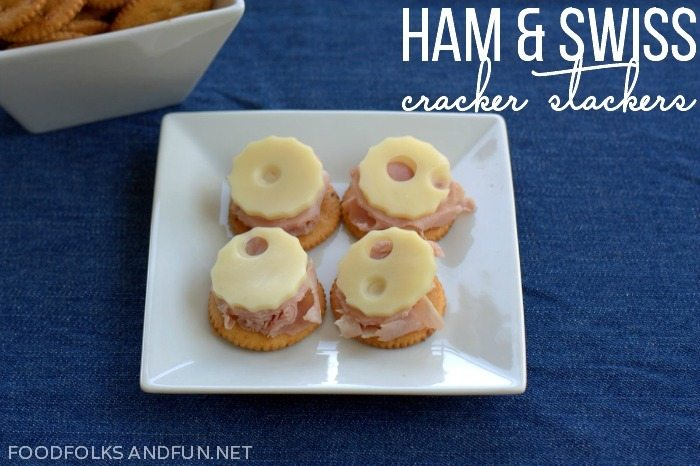 Ham and Swiss Cracker Stackers on a white plate.