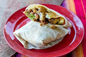 MEGA Breakfast Burrito Recipe – these breakfast burritos are massive and stuffed with my secret ingredient that makes them incredible!