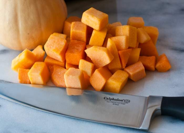 Cut butternut squash with a chef\'s knife