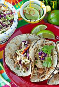 3 pork tacos on a red plate.