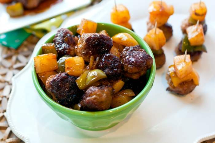 A bowl of sweet and sour cocktail meatballs
