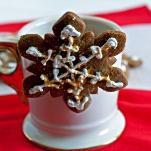 Gingerbread Cookie hanging from the side of a cocoa cup
