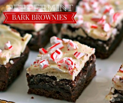 Close up of a brownie with melted white chocolate and broken pieces of candy cane.
