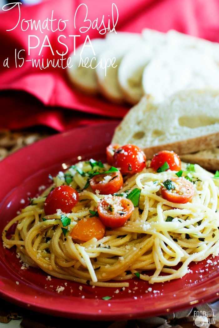 Spaghetti with basil, parmesan, and cherry tomatoes.