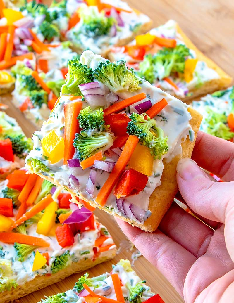 Crescent Roll Pizza loaded with broccoli, carrots and bell pepper.