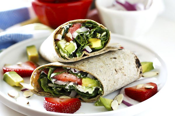 Avocados, strawberries, chicken, red onion, toasted almonds, goat cheese, and zesty poppy seed dressing combine to make these deliciously easy wraps. They're great for quick lunches and even easy dinners!