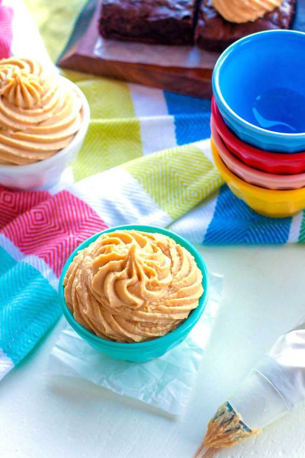 Overhead shot of peanut butter frosting in bowls.