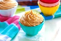 Piped frosting in small bowls.