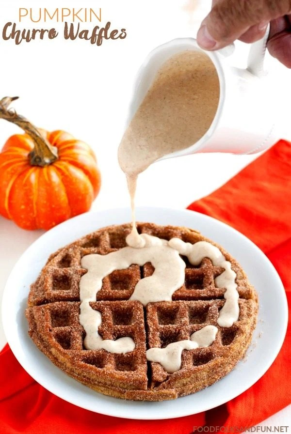 These Pumpkin Churro Waffles are crisp on the outside and creamy on the inside, almost soufflé-like. They're coated with spiced sugar and drizzled with a spiced cream cheese glaze. via @foodfolksandfun
