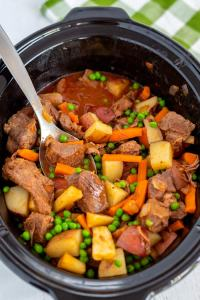 The finished beef stew inside of a slow cooker.