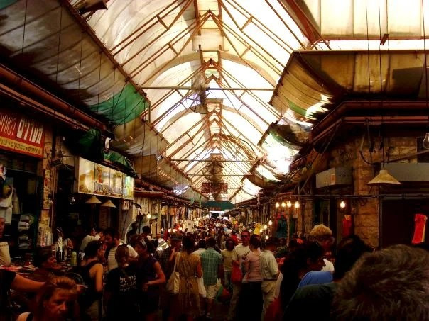 The Shuk in Jerusalem busy with people.