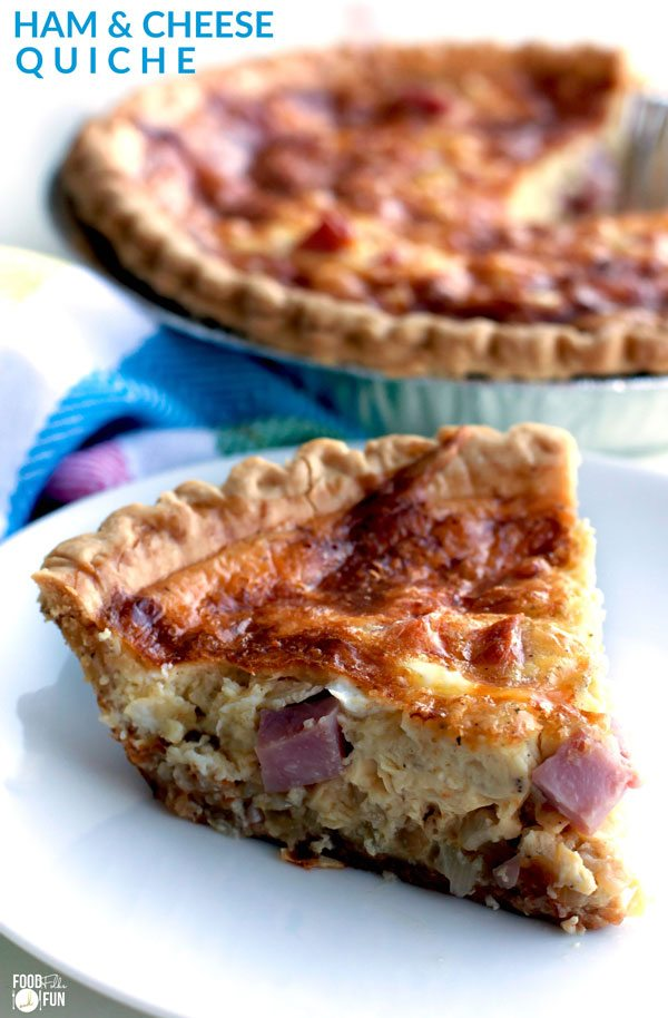 A slice of quiche on a white plate.