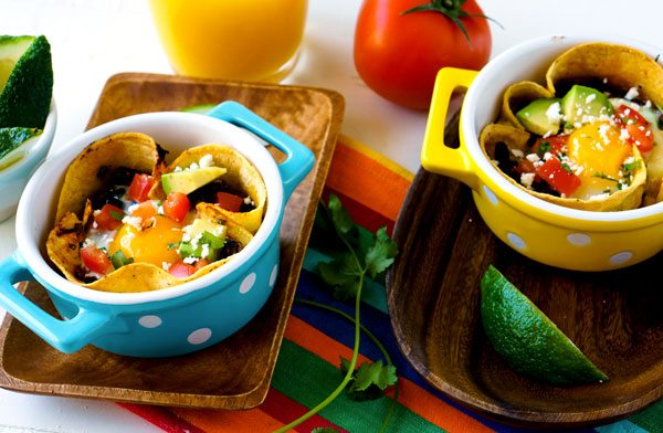 Huevos Rancheros Breakfast Bowls in colorful ramekins.