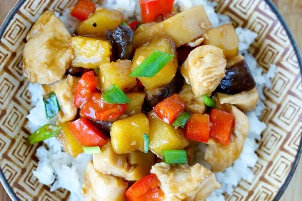 Close up picture of chicken teriyaki served over rice.