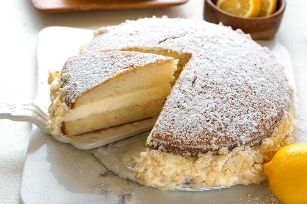 Slicing a piece of Olive Garden Lemon Cream Cake Copycat